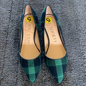 Navy and emerald green dress heels.